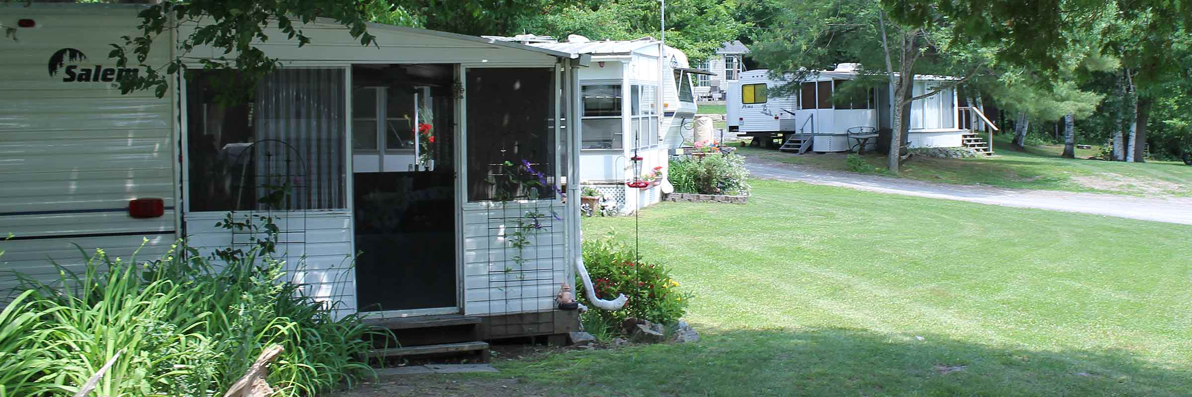 Several trailer sites in White Lake in the Pickerel Bay Lodge Campground